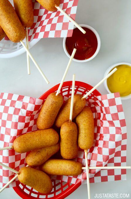Easy Homemade Mini Corn Dogs |  The traditional Fair food just got teeny. For party fun, make a batch of these little nostalgic bites and dip them in your favorite condiments. @justataste