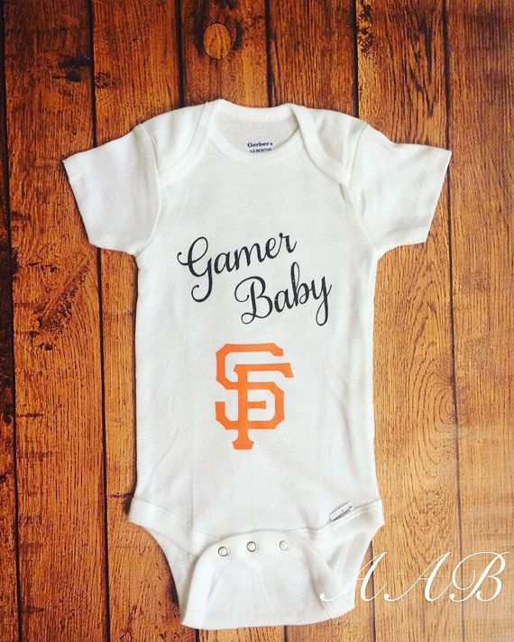 This listing is for one Gamer Baby and SF emblem on a baby bodysuit. Perfect for your little ones first SF Giants outfit, game-day, photos, etc! Gamer Baby is in black glitter with the SF logo in orange. Please choose the appropriate size from the drop down menu above.  More outfits available in my shop: www.etsy.com/shop/averyannboutique ~**~ Many of my items are novelty items and contain small pieces. Always make sure that your child is wearing appropriately to prevent choking ~**...