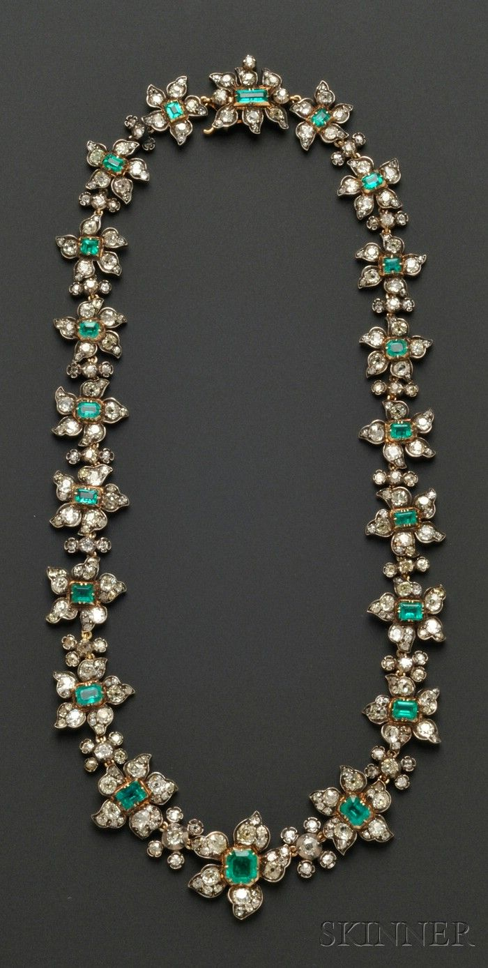 Antique Emerald and Diamond Necklace, France, composed of floral links each centering an emerald-cut emerald graduating in size from approx. 7.75 x 7.15 x 5.30 to 3.65 x 3.25 x 1.85 mm, petals set with old mine-cut diamonds, approx. total diamond wt. 28.50 cts., silver-topped 18kt gold mount, lg. 18 1/4 in., guarantee stamps. Victorian or Victorian style