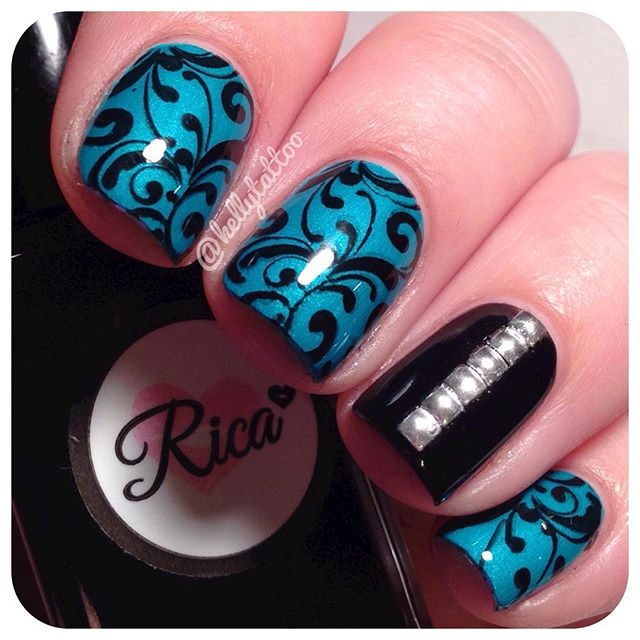 #nailart .. I love the design on these nails the teal sets it off. Thr black & the rinestones make it a pretty combo シ