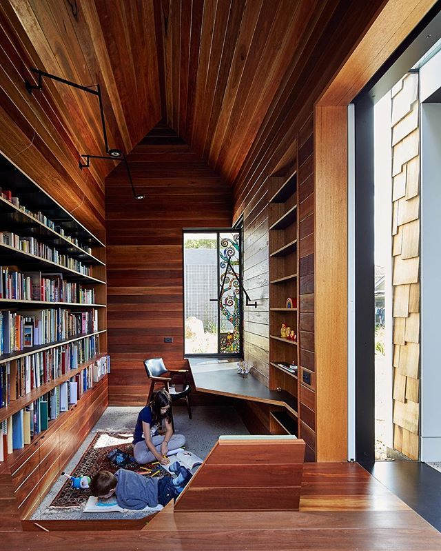"The library is lined in reclaimed spotted gum that Maynard says ""brings with it wisdom from its previous life."" #interior #library #modern #dwell  Photo by @peterbbennetts Architecture by Andrew Maynard and Mark Austin Location: Melbourne, Australia"