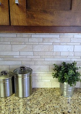 Tile backsplash: natural colors of stone, goes well with granite, and would complement white cabinets