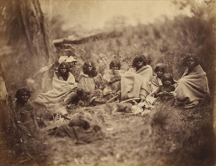 Culture Victoria - Group of Aboriginal women and children, sitting in a bushland setting