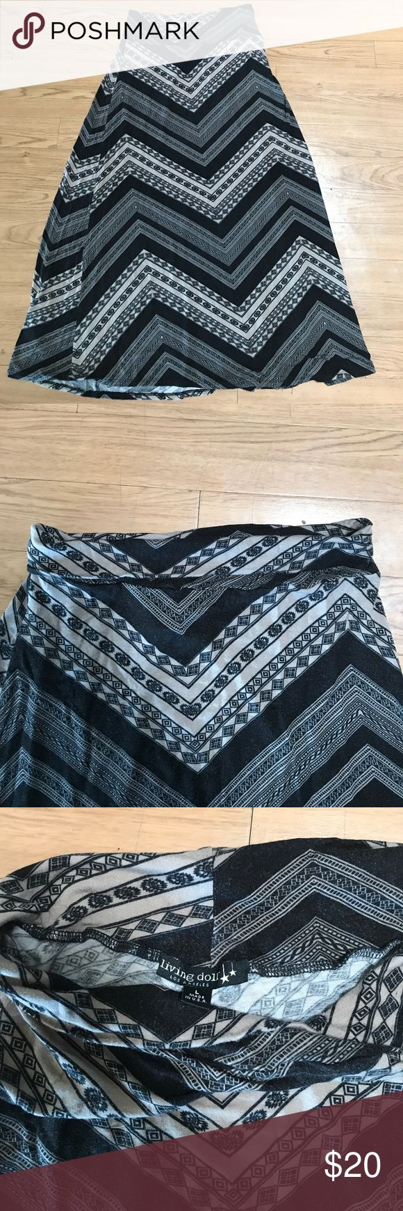 Black and Tan maxi skirt Very soft Black and Tan maxi skirt with adorable tribal detail. In great condition. The skirt is a large but fits more like a medium. It is very stretchy and can also fit a large. Living Doll Skirts Maxi