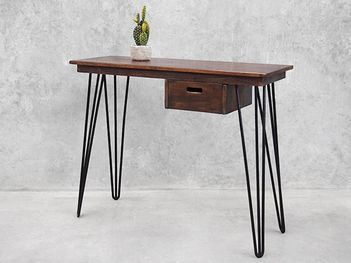 A modern industrial take on a classical retro design. This Holy Funk console with hairpin legs comes complete with its own drawer just because! View online now