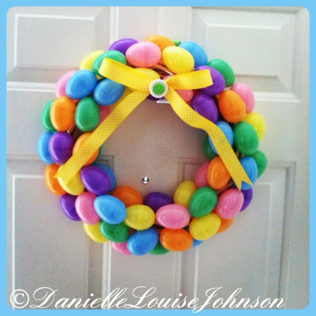 Easter egg wreath!  (simple and cheap! Eggs & wreath $1 at dollar tree. Ribbon & buttons $1.97 at Walmart. Hot glue the eggs onto wreath. Add bow and buttons and it's done!) ;) <3