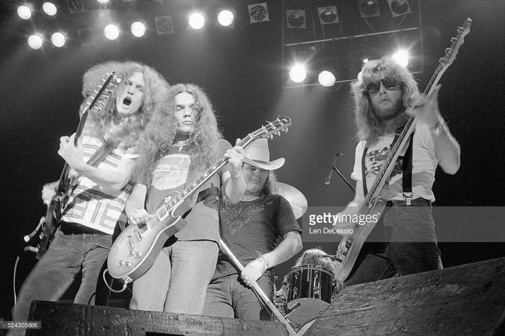 Allen Collins, Gary Rossington, Ronnie Van Zant and Leon Wilkeson perform at The Academy of Music, in New York City.