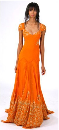 Saffron silk-chiffon long dress with gold hand-embroidered detail.  Marchesa Collection.