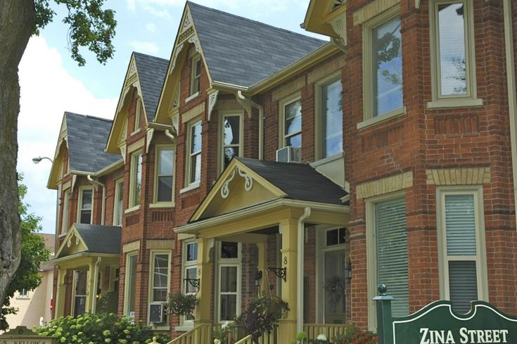 These Queen Anne style townhouses on historic Zina Street have beautiful, intricate gingerbread gables and brackets.