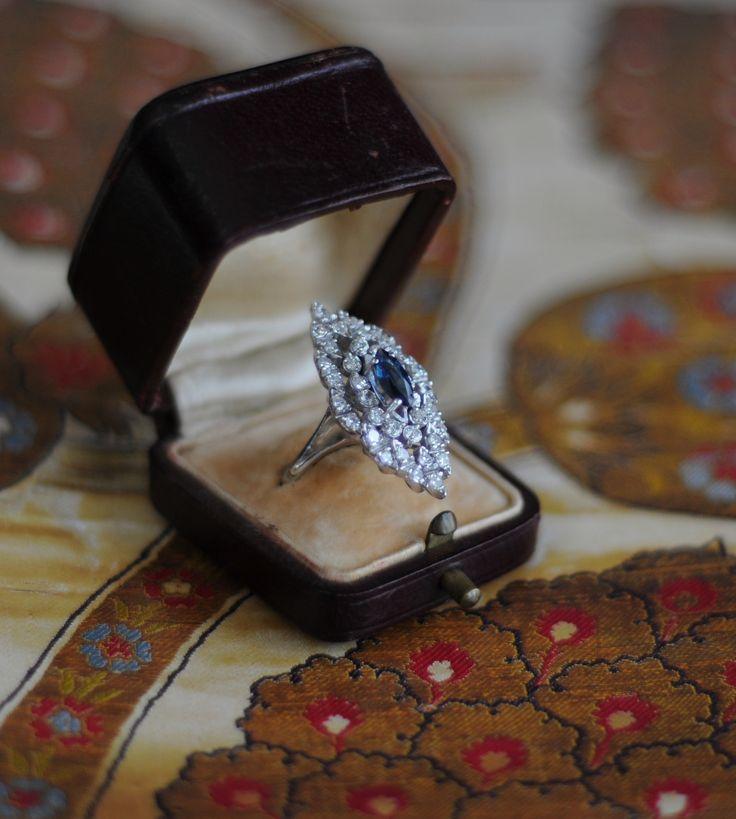 Centering a marquise cut sapphire weighting approximately .80 carat framed by round diamonds approximately 1.60 carat navette ring. Available now in OZER antique jewelry .collection.   /   Merkezinde yaklaşık .80 karat markiz kesimli Safir ve onu çevreleyen 1.60 karat elmaslarla bezeli mekik formlu zarif yüzük. Antika mücevher koleksiyonumuzda bulabilirsiniz. instagram @ozer_artantiques