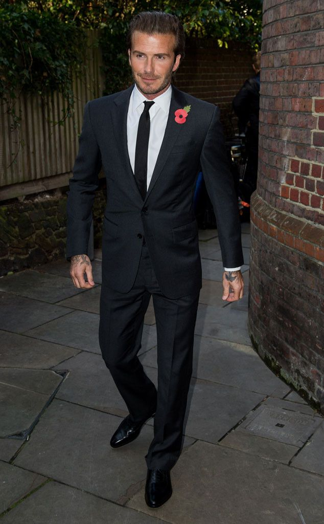David Beckham looks super suave in a suit! : this was him yesterday on facebook digital stadium!