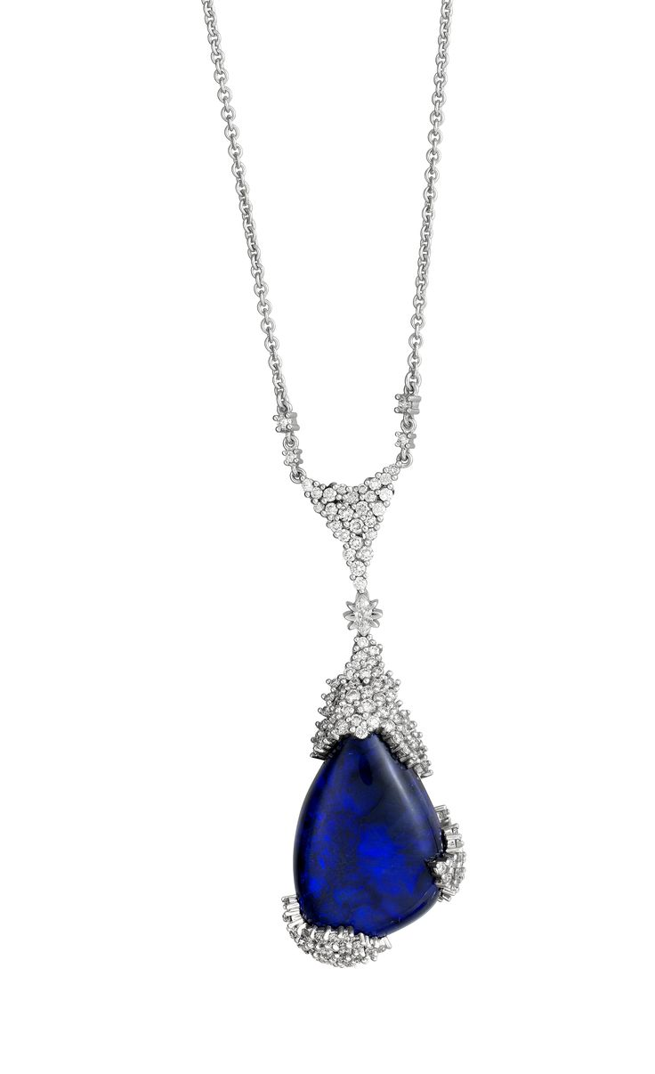 Starry Starry Night. A beautiful deep blue Opal encased by graduating round white diamonds.