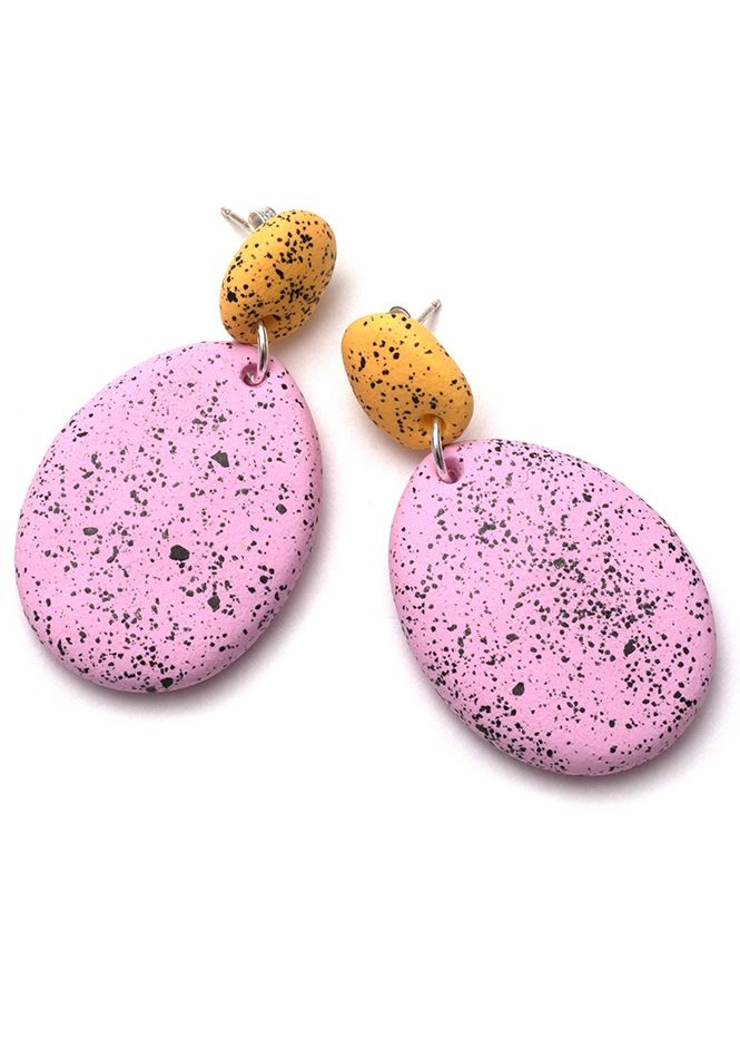 Hand-formed two-part drop earrings made from buttercup yellow and fondant pink coloured polymer clay with graphite black speckles. Earrings measure approximately 1cm in diameter at the top and 4cm in diameter at the bottom and they hang from sterling silver posts.