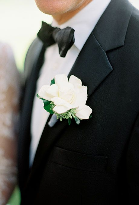 Brides: A Classic White Gardenia Boutonniere. A small white gardenia boutonniere accented with dusty miller created by Amaryllis Floral and Event Design.