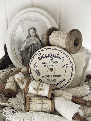 vintage lace on wooden spools