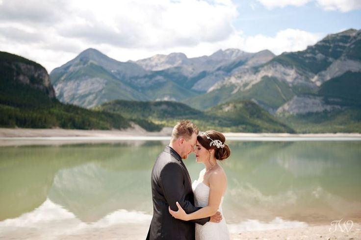 bride and groom at their Rocky Mountain elopement at Barrier Lake captured by Tara Whittaker Photography   Kananaskis Country