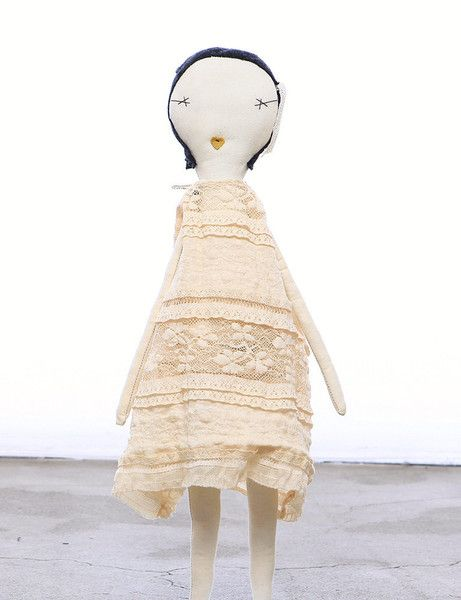 A rag doll from Jess Brown makes a truly unique friend for your little girl. This beautiful doll is inspired by Coco from the book Kiki and Coco in Paris, and comes dressed in a wonderful vintage lace dress and matching hair ribbon
