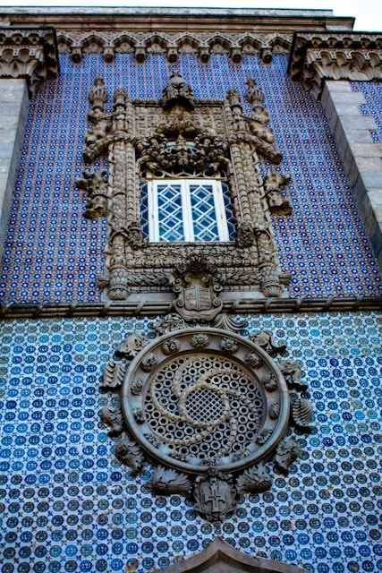 Windows of Sintra, Portugal. Portugal embraces color. There are beautiful tiles in the oddest places - from the fanciest hotels and homes, to regular little family run diners. #Sintra #Portugal #stunning #facade #art #azulejo #tiles #architecture #palace #Pena #Portugal #holidays #travel