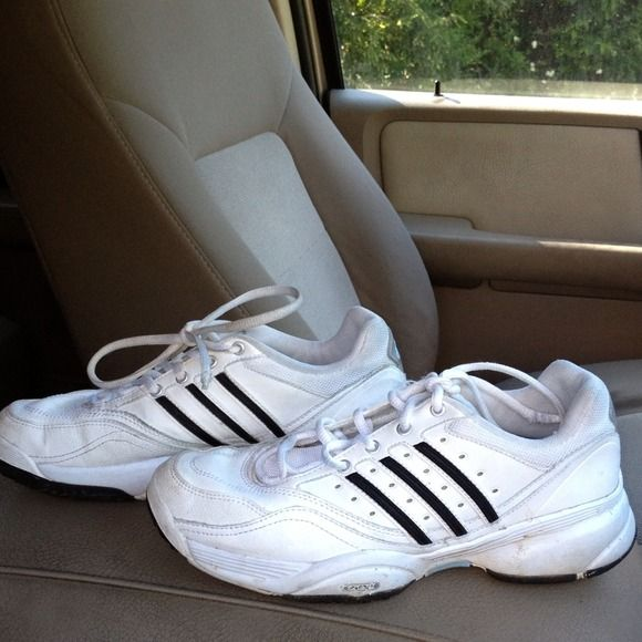 Like new pair of Addias shoes White pair of Addias shoes with black stripes size 6 1/2 in good condition just need cleaning off Adidas Shoes
