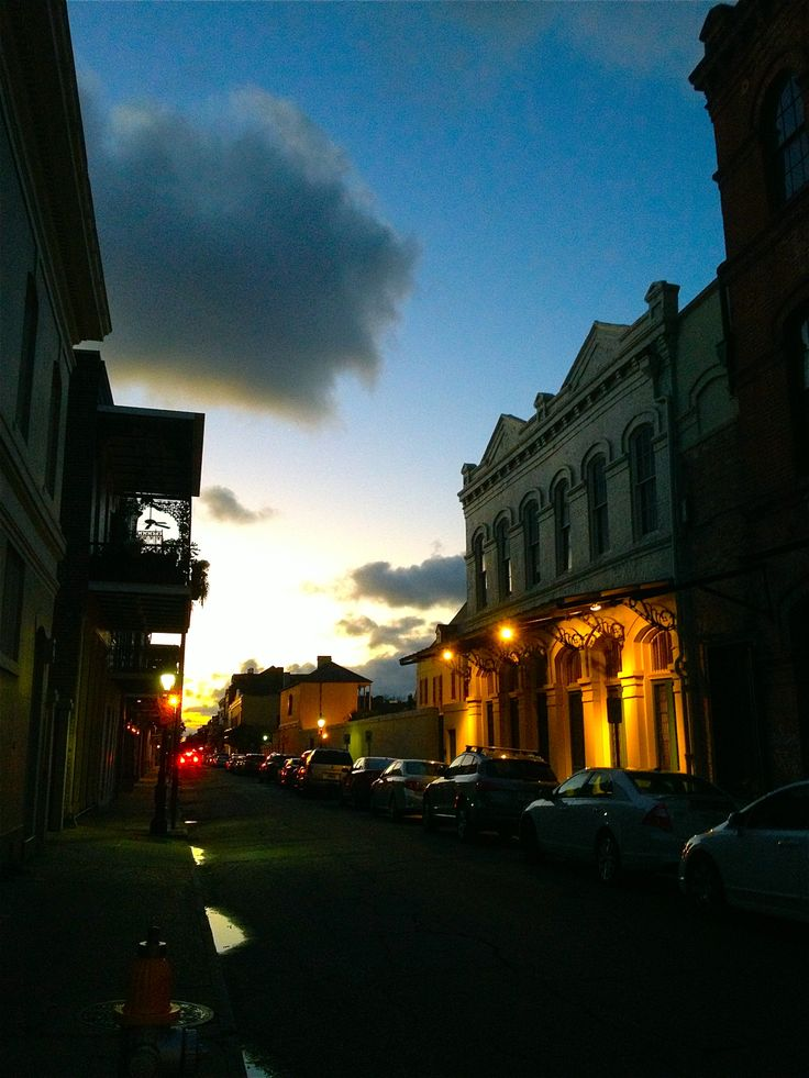 a street in the French Quarter, at dusk.