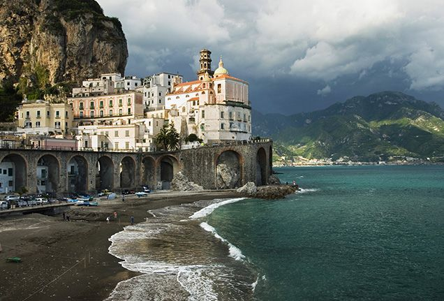 """Amalfi Coast, Italy Gorgeous roads and scenery abound in Italy. Motorists the world over are drawn to the country's highways and thoroughfares, from the picturesque landscape of the Lake Como district to the famous Stelvio Pass through the Eastern Alps. Our pick is the Amalfi Coast, an area designated as """"an outstanding example of Mediterranean landscape"""" by UNESCO, and for good reason. With soaring bluffs and charming hillside villages, the Amalfi Coast provides a challenging drive peppered…"""