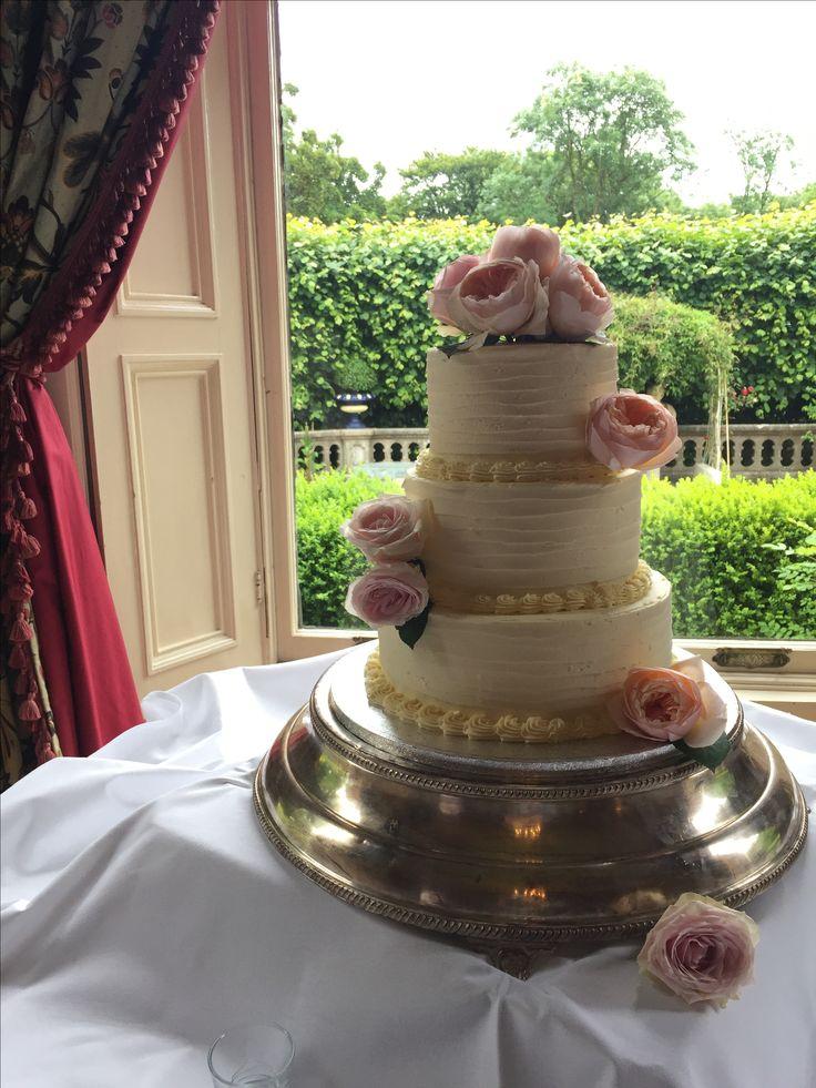 Soft iced cake dressed with fresh David Austin roses.