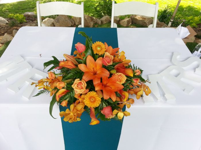 Sweetheart table teal and orange wedding reception