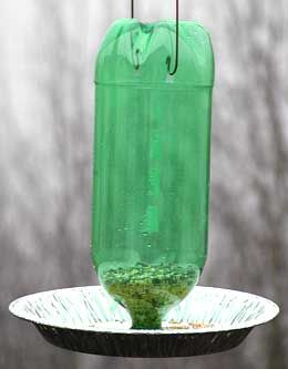 Two Liter Bird Feeder {2 liter pop bottle, A pie tin, Clothes hanger,   Needle nose pliers, scissors/knife}