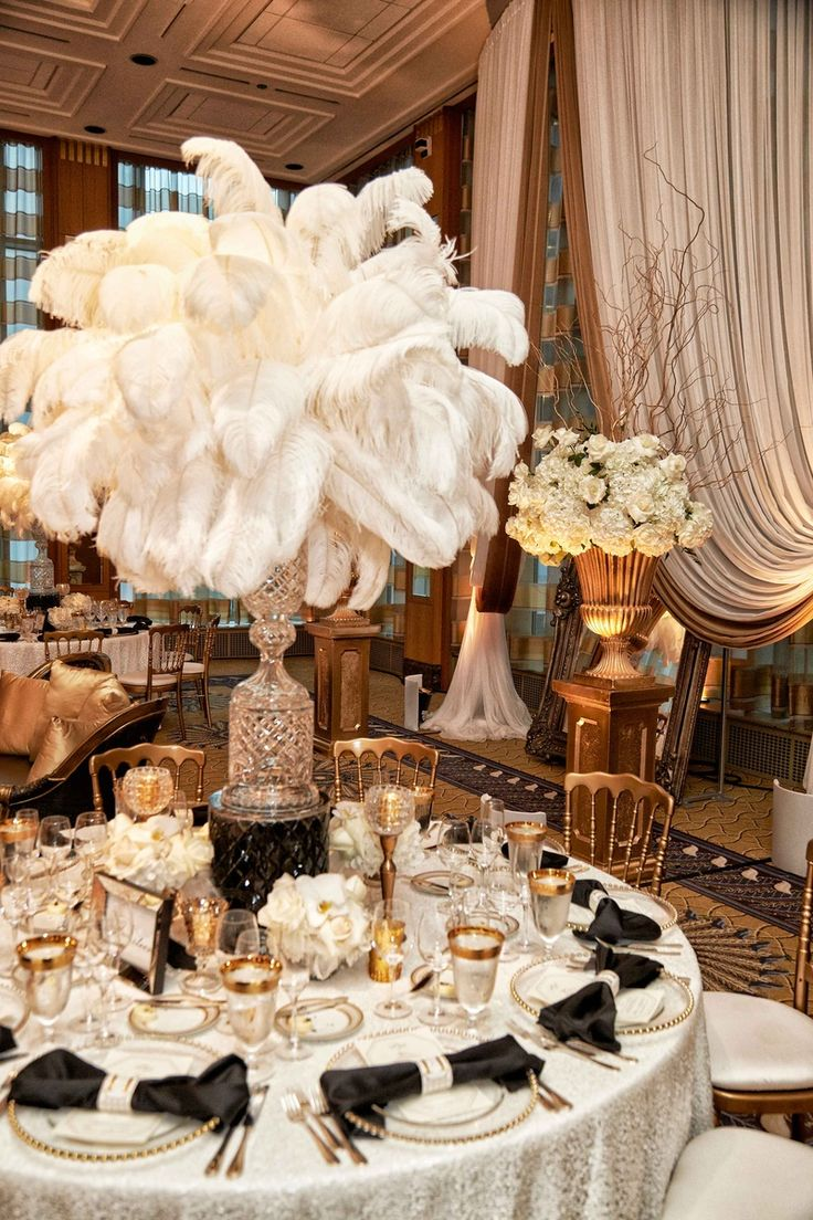 Glamorous White Feather Centerpiece | Photo: KingenSmith. View More:  http://www.insideweddings.com/weddings/elegant-vintage-inspired-destination-wedding-in-chicago/920/