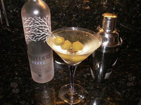Hands down- my favorite drink! 3oz Vodka 1oz Vermouth Splash of Olive Brine Shaken, not stirred, of course :)