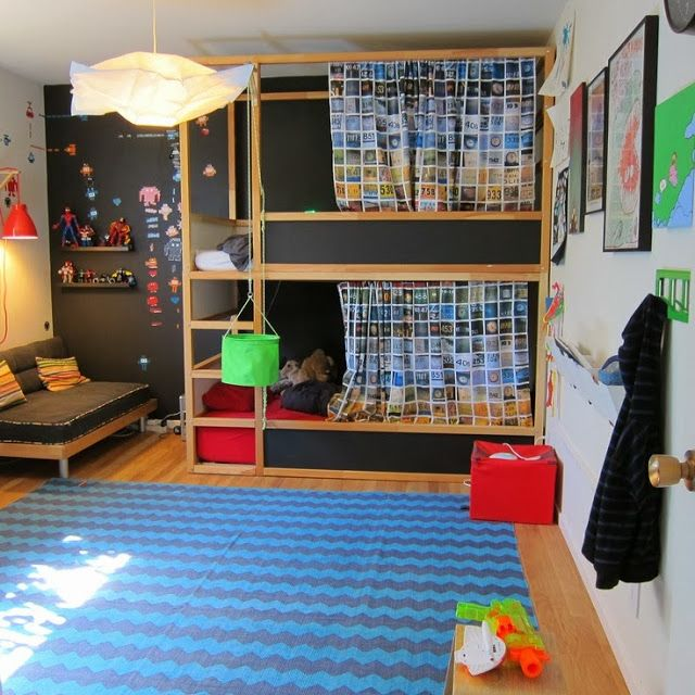 Ikea Kura bunk beds, double stacked and painted with chalkboard paint and curtained.