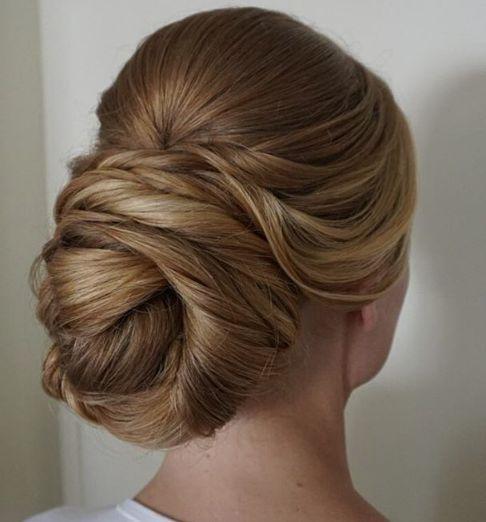 Gorgeous twisted back low bun wedding hairstyle; Featured Hairstyle: Heidi Marie Garrett