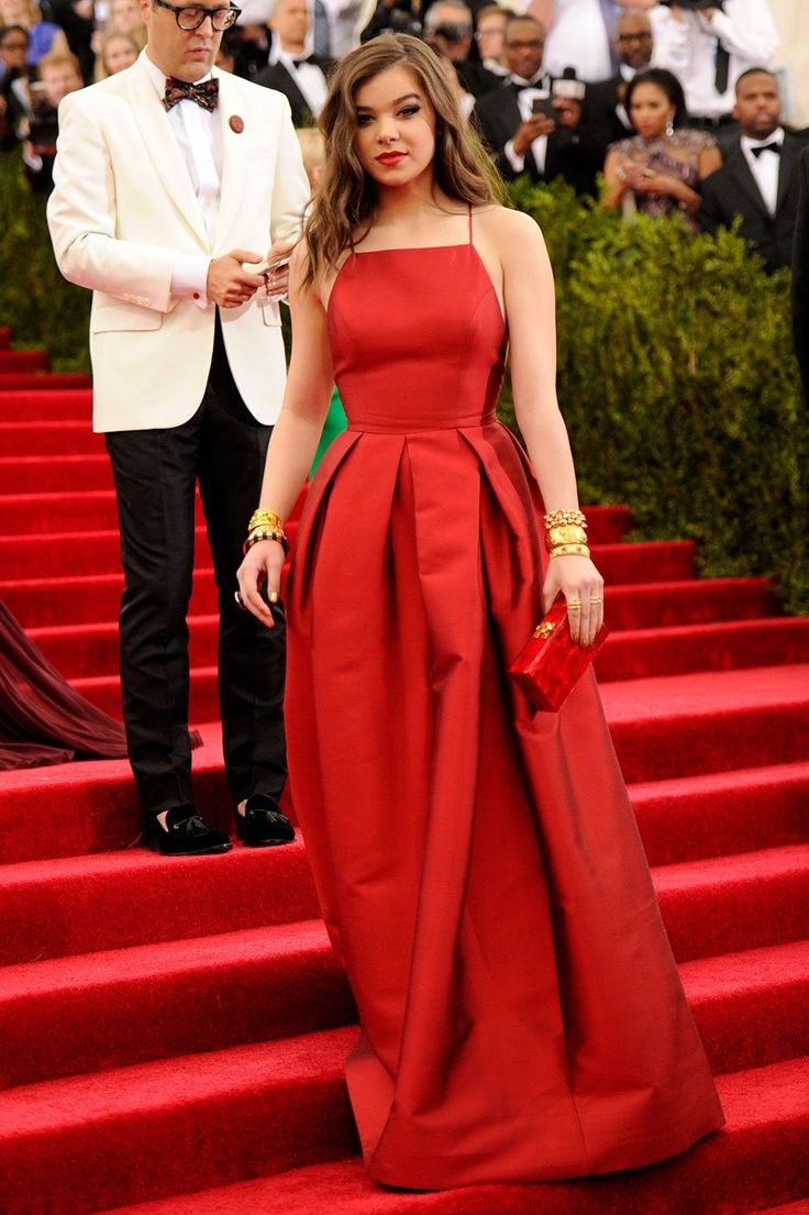 Hailee Steinfeld in a blood-red Michael Kors satin gown at 2015 Met Gala held at the Metropolitan Museum of Art in New York City (4-5-15) Monday.