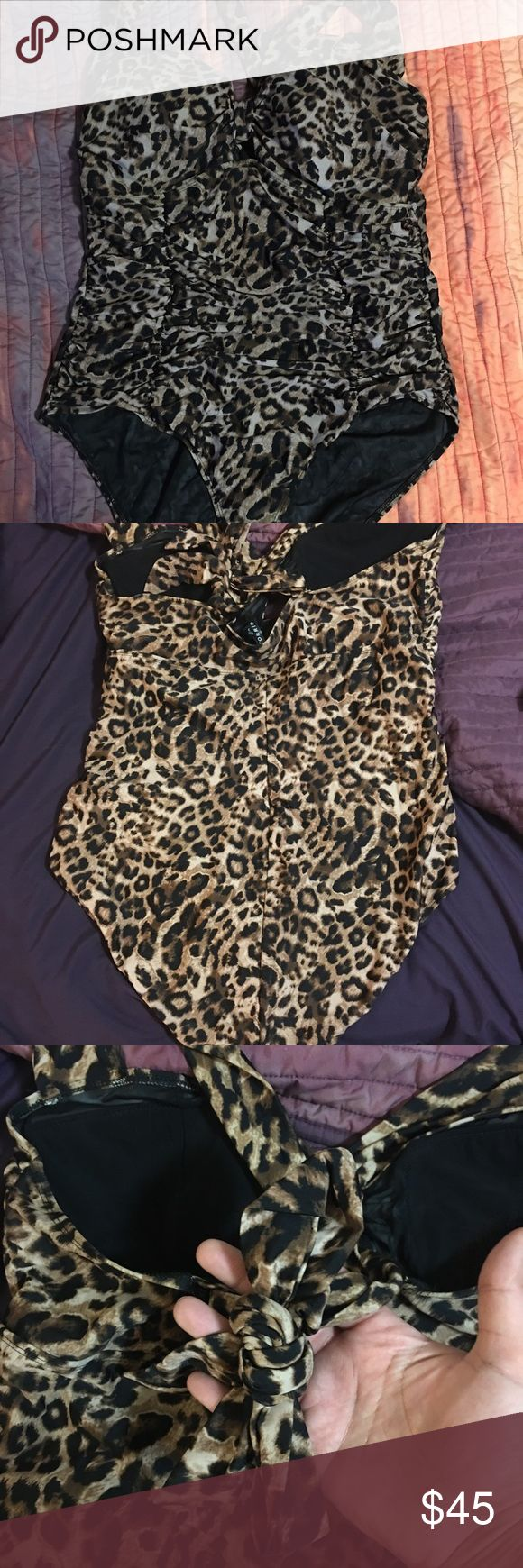 Torrid swimsuit sz 3 Super sexy animal print one piece swim suit from torrid size 3! Love this swimsuit only wore a handful of times and no longer fits :( excellent condition. torrid Swim One Pieces