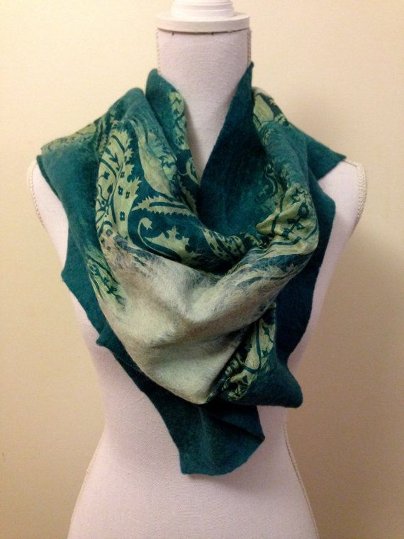 Dark and light green felted wool shawl with pretty floral silk inlay - soft, warm and beautiful. Made in Turkey using best quality wool from Australia and New Zealand along with sari silk from India. These are hand made and hand dyed using traditional methods. Dyes include colours created using natural elements such as walnut and onion skin. They are absolutely beautiful either worn casually or dressed up for a special occasion. The shawl has areas of contrasting coloured felt incorporated…