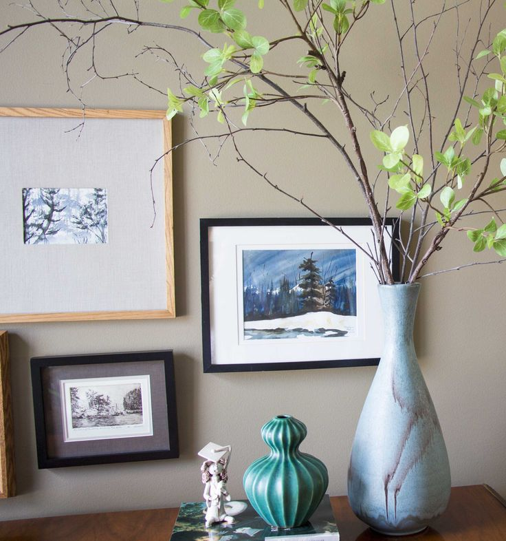 gallery wall with large vase and branches, turquoise vase and Bencini statue