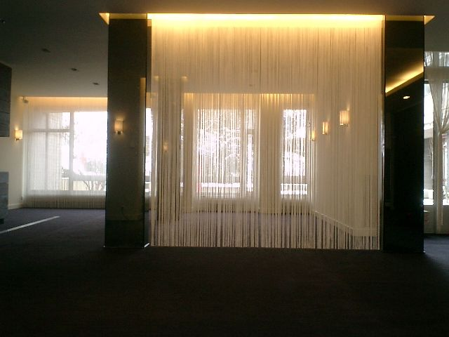 String Curtains Create a separate space without losing light. They can be trimmed to any length, too!