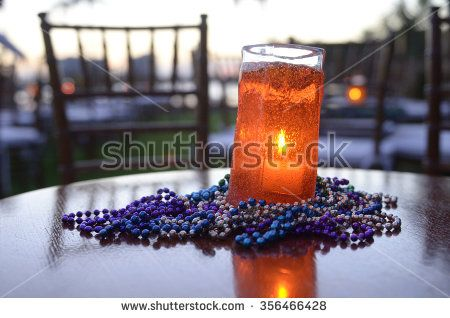 Table arrangement of beads and candles