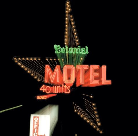 Colonial Lodge Motel, Elgin, Illinois. This Las Vegas–style sign, which stands 60–70 feet tall, looks exactly the same as when it was constructed in 1955 except that it no longer rotates, which is against Elgin law anyway, says owner Joe Vanaria. He loves its uniqueness and ignores well-meant marketing advice to get with the times and install a Holiday Inn–style sign.