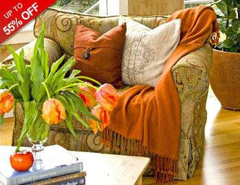 Fall in love with cozy, festive living room additions this season to totally autumn out your couch. Try a set of pillows in burnt orange, eggplant, rich browns, and muted blues, and add a fuzzy throw for ultimate snuggling. Keep the warm toasty with a new set of curtain panels, and add an instant autumn touch to your coffee table with a faux sunflower centerpiece.