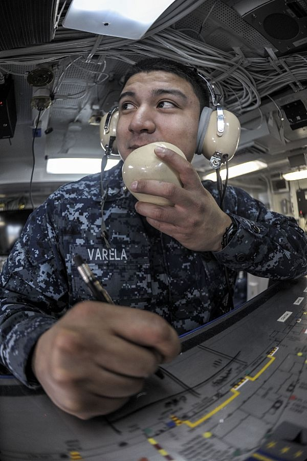130205-N-HN953-046 EVERETT, Wash. (Feb. 5, 2013) Aviation Boatswain's Mate (Handling) 3rd Class Manuel Varelo practices with the flight deck ouija board in flight deck control aboard the aircraft carrier USS Nimitz (CVN 68). Training is conducted regularly aboard Nimitz to maintain operational readiness of the crew. (U.S. Navy photo by Mass Communication Specialist 2nd Class Robert Winn/Released)