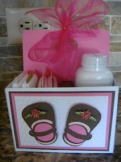 This is so fun! Check out Tina Time's blog post to get the scoop on this baby present. This is so adorable. I love the little shoes.