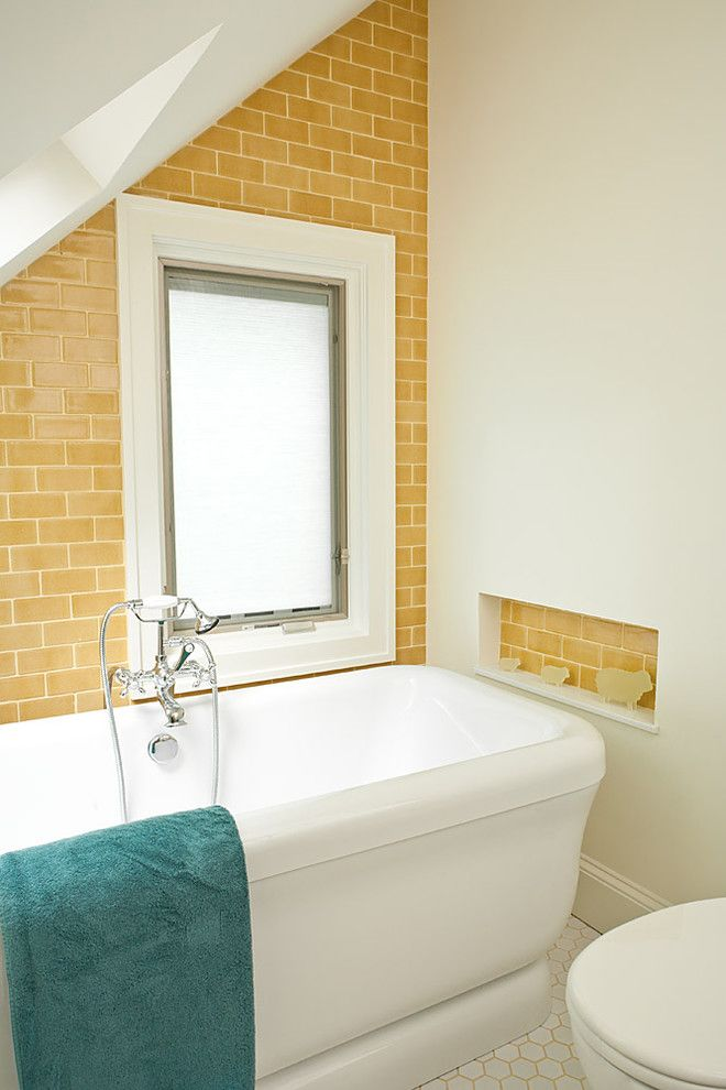 yellow subway tile and cute contrasting tile bath niche