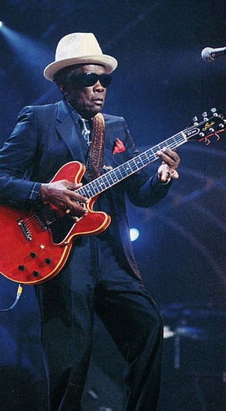 John Lee Hooker A lesson in how to look cool. http://www.guitarandmusicinstitute.com http://www.guitarandmusicinstitute.com