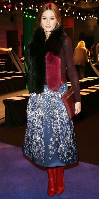 At the Peter Pilotto fall/winter 2014 show, Palermo showed her support in a full printed midi skirt that she styled with an oxblood long-sleeve top, a Charlotte Simone fur stole, and red accessories.