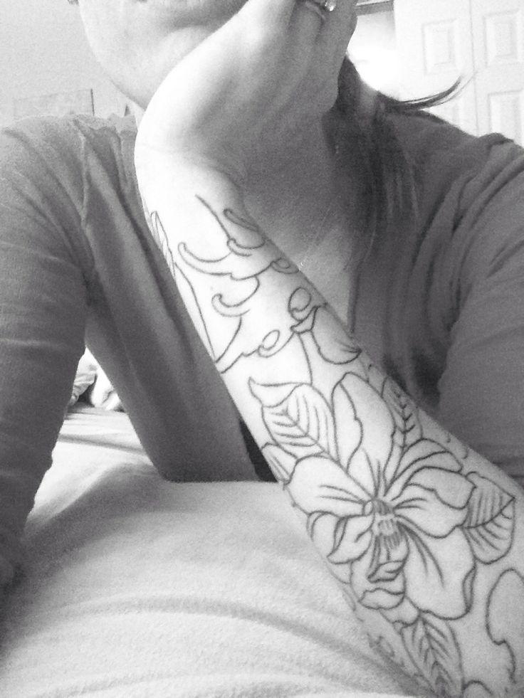 Magnolia tattoo by Charlie jones at river city tattoo