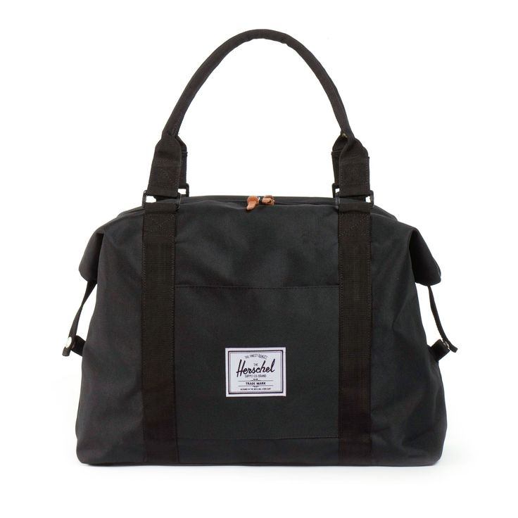 Herschel Supply Co. Black Strand Duffle Bag: Herschel strand black duffle bag. the bag is lined with signature coated poly fabric, features full grain leather zipper pulls, snap-down sides with branded metal detail. Also has an external sleeve pocket and padded top handles.