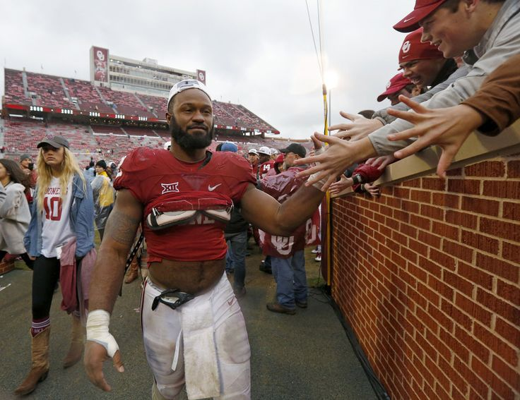 Oklahoma's Samaje Perine (32) celebrates with fans after the Bedlam college football game between the Oklahoma Sooners (OU) and the Oklahoma State Cowboys (OSU) at Gaylord Family - Oklahoma Memorial Stadium in Norman, Okla., Saturday, Dec. 3, 2016. Oklahoma won 38-20. Photo by Bryan Terry, The Oklahoman