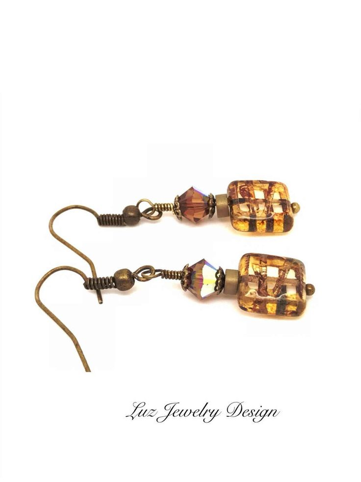A personal favorite from my Etsy shop https://www.etsy.com/listing/501173360/brown-brass-boho-bohemian-brown-earrings