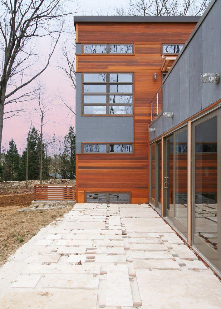 T1 11 Cedar Siding With Contemporary Exterior And Cable Railing Dark Gray Exterior Dark Grey Exter Flat Stone Patio Stone Patio Designs Concrete Patio Makeover